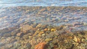 Sjöfrikändvatten Gör en härlig sten under Royaltyfria Bilder