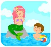 Sjöjungfru och en pojke Fotografering för Bildbyråer