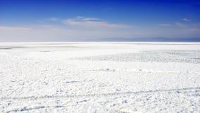 Sjölandskap med snö på isen Fotografering för Bildbyråer