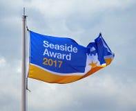 Sjösidautmärkelse för blå flagga Fotografering för Bildbyråer