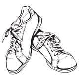 Sjaskiga rinnande skor i svart färgpulver Fotografering för Bildbyråer