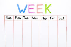 Sju dagar av veckahandstilen på det vita brädet royaltyfri fotografi