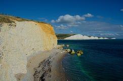Sju systerkritaklippor fr?n hopp Gap Sussex UK arkivbild