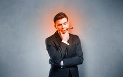 Sjuk affärsman med att bränna rött head begrepp royaltyfri bild