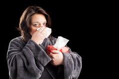 Sjuk kvinna på svart bakgrund Royaltyfri Foto