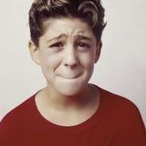sjuk rubbning för 2 pojke Arkivfoto