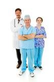 sjukhusläkarundersökningpersonal Arkivfoto