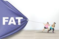Sjukligt fet text för kvinnafriktionsfett Arkivbilder