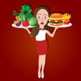 Sjukligt vs den sunda matkvinnaflickan som är vald mellan skräpmat eller grönsaken Royaltyfri Foto