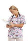 sjuksköterskaståendebarn Arkivbilder