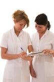 sjuksköterskor två barn Arkivbilder