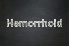 Sjukvårdbegrepp: Hemorrhoid på svart tavlabakgrund fotografering för bildbyråer