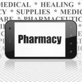Sjukvårdbegrepp: Smartphone med apotek på skärm Royaltyfri Bild