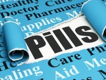 Sjukvårdbegrepp: svarta textpreventivpillerar under stycket av sönderrivet papper Arkivfoton