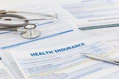 Sjukvårdgranskning och information om försäkring Royaltyfria Bilder