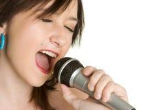sjunga för flicka som är tonårs- royaltyfri fotografi