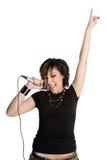 sjunga för flickamikrofon Arkivfoton