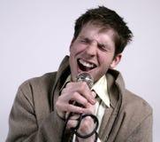 sjunga för grabb Fotografering för Bildbyråer