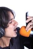 sjunga för ringtone Arkivfoton