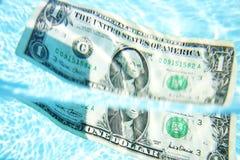 sjunka för dollar Fotografering för Bildbyråer