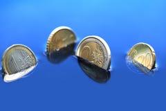 Sjunka mynt Arkivbild