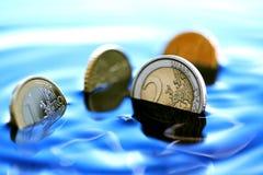 Sjunka mynt Royaltyfri Bild
