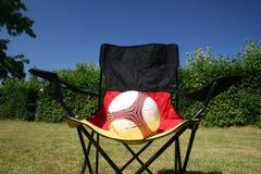 sjunken tysk fotboll för boll stol Arkivbild