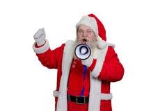 Skäggiga Santa Claus som ropar i megafon Fotografering för Bildbyråer