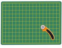 skärare som klipper mattt roterande Arkivbild