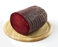 Skärbräda med Bresaola salami Royaltyfria Bilder