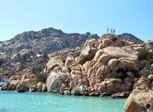 Skärgård Maddalena, strand för Caprera ö, Cala Coticcio Himmel på jord fotografering för bildbyråer