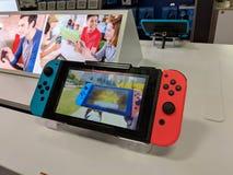 Skärm för Nintendo strömbrytare på royaltyfri bild