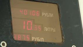 Skärm med att räkna bensinliter och dess kostnad lager videofilmer
