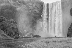 Skógafoss waterfall. With a person in black and white, Iceland Stock Images