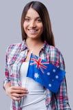 Skönhet med den australiska flaggan Fotografering för Bildbyråer