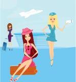 Resa flickor i flygplatsen Royaltyfria Bilder