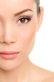 Skönhetframsidacloseup - asiatisk kvinna arkivbild