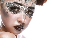 Skönhetkvinna i futuristic makeup Royaltyfria Foton