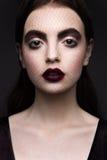 Skönhetmodemodell Girl med mörkt smink Arkivbilder