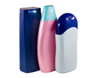 Skönhetsmedelflaskor på ljus bakgrund Royaltyfria Bilder