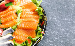 sköt sushi för black set Olika sashimi, sushi och rullar Royaltyfri Fotografi