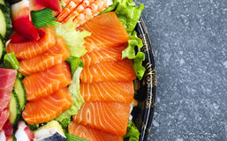 sköt sushi för black set Olika sashimi, sushi och rullar Royaltyfria Bilder