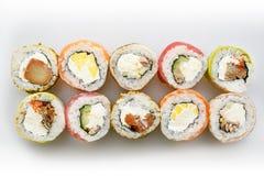 sköt sushi för black set Rolls med laxen och grönsaker Arkivfoton