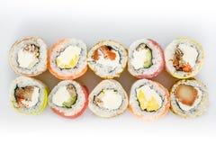 sköt sushi för black set Rolls med laxen och grönsaker Royaltyfri Fotografi