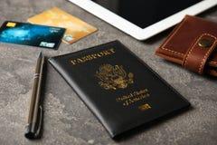 Skład z paszportem i portfel na popielatym stole obrazy royalty free