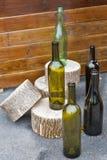 Skład z pustymi wino butelkami plenerowymi Obraz Stock