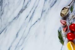 Składniki na marmurowej teksturze Fotografia Royalty Free