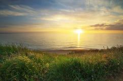 składu trawy zielonego morza nieba zmierzch Fotografia Stock