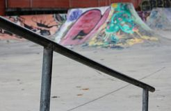 Sk8 Rail. Rail in a sk8 park in Caldas da Rainha - Portugal with ramps and graphites as background Royalty Free Stock Photography