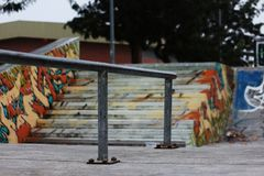 Sk8 Rail. Rail in a sk8 park in Caldas da Rainha - Portugal with a stairs and graffiti as background Royalty Free Stock Photography